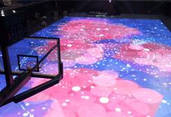 Foto zu Sportevents: Basketball Spielfeld mit LED Boden und Motion Tracking als Trainingshilfe