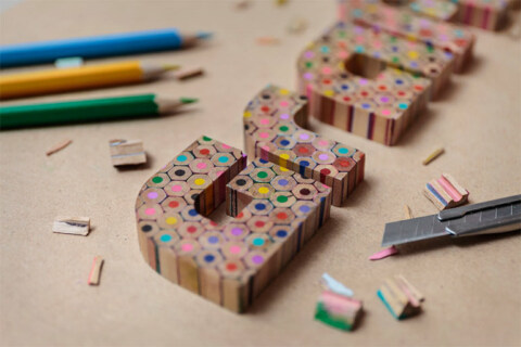 Artikelbild für: Typografie: Dreidimensionales Logo aus Buntstiften – von Grafixd